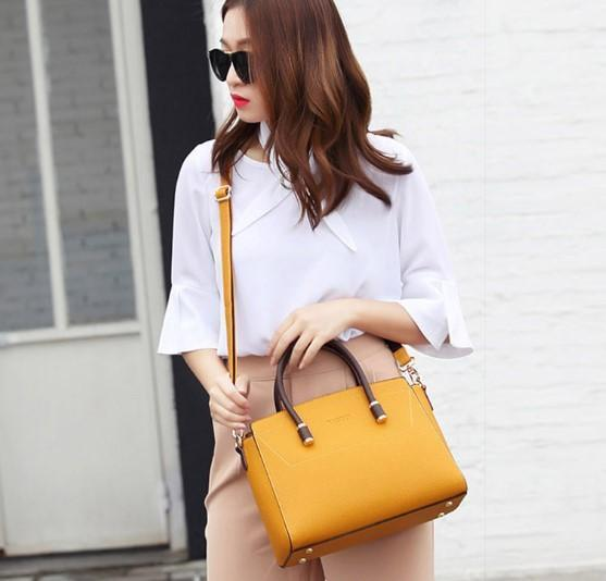 professional stylish woman with yellow handbag side close view