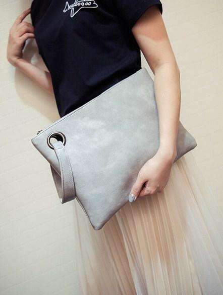 Casual Stylish Woman With Grey Wrist Clutch - Front View