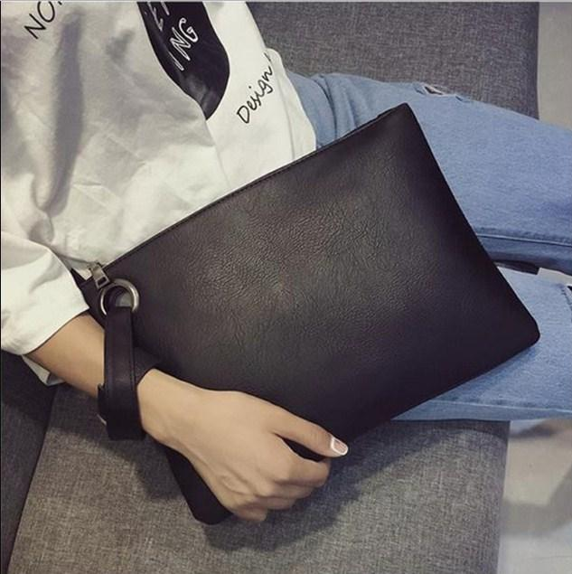 Casual Stylish Woman With Grey Wrist Clutch - Side View