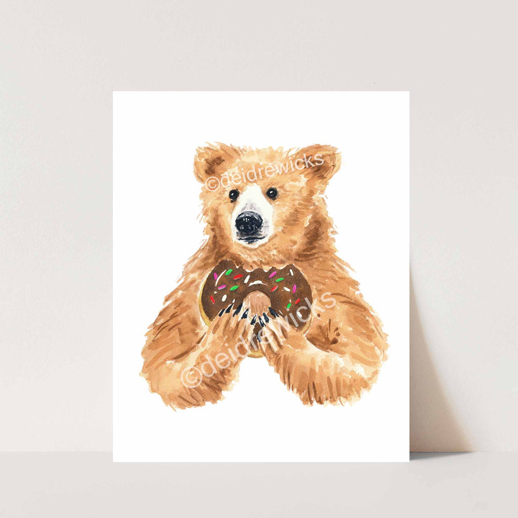 Kitchen and nursery art by Artist Deidre Wicks, this one is a Grizzly bear holding a doughnut
