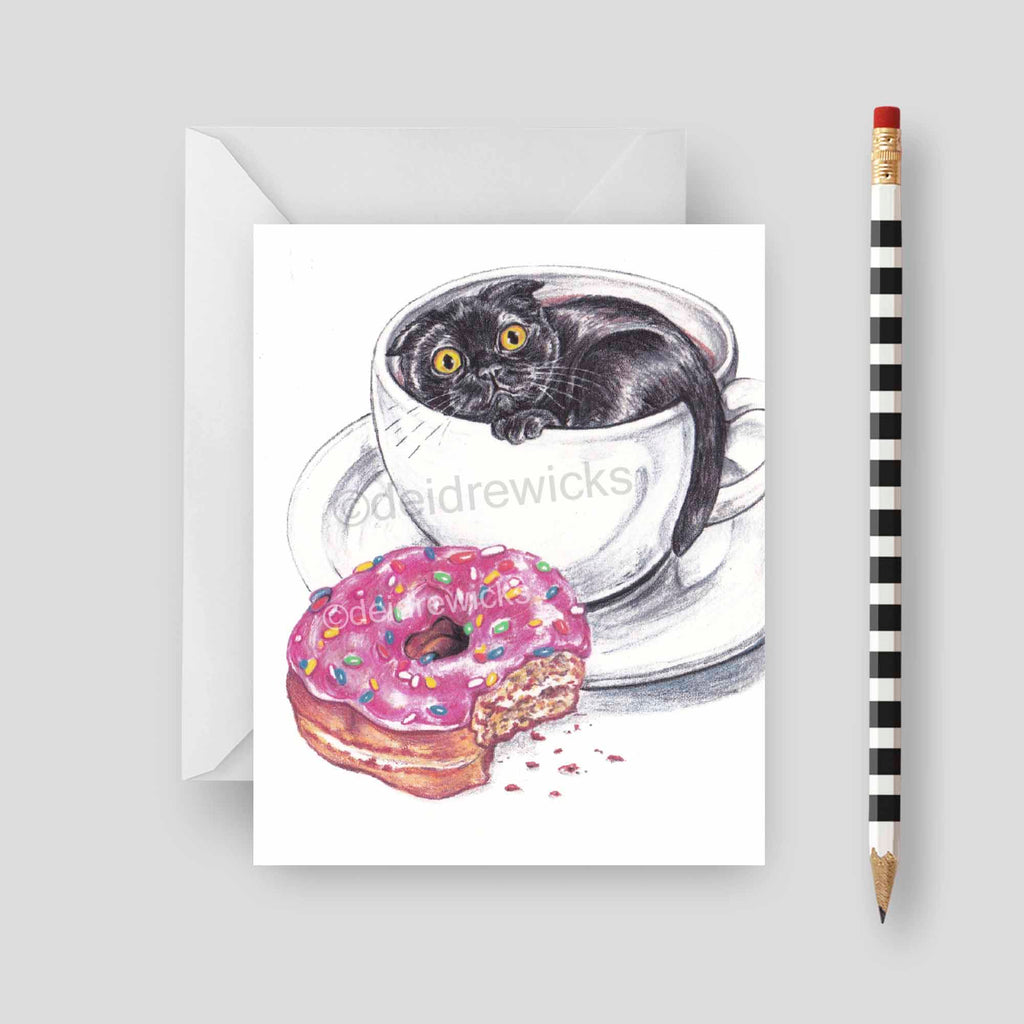 Blank greeting card featuring a black cat in a coffee cup with a sprinkle donut beside it