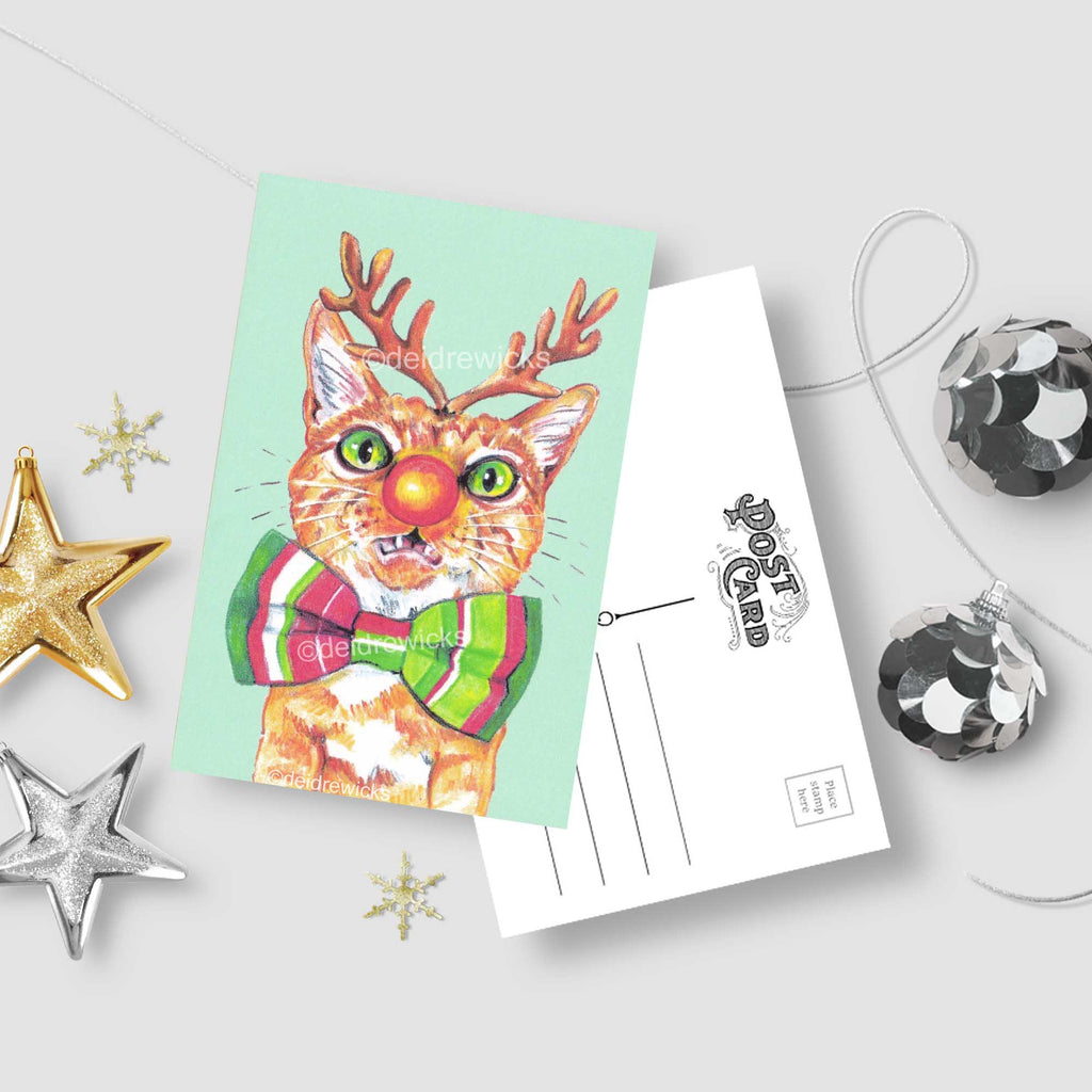 Christmas postcard -  orange tabby cat with reindeer antlers and a Rudolph nose