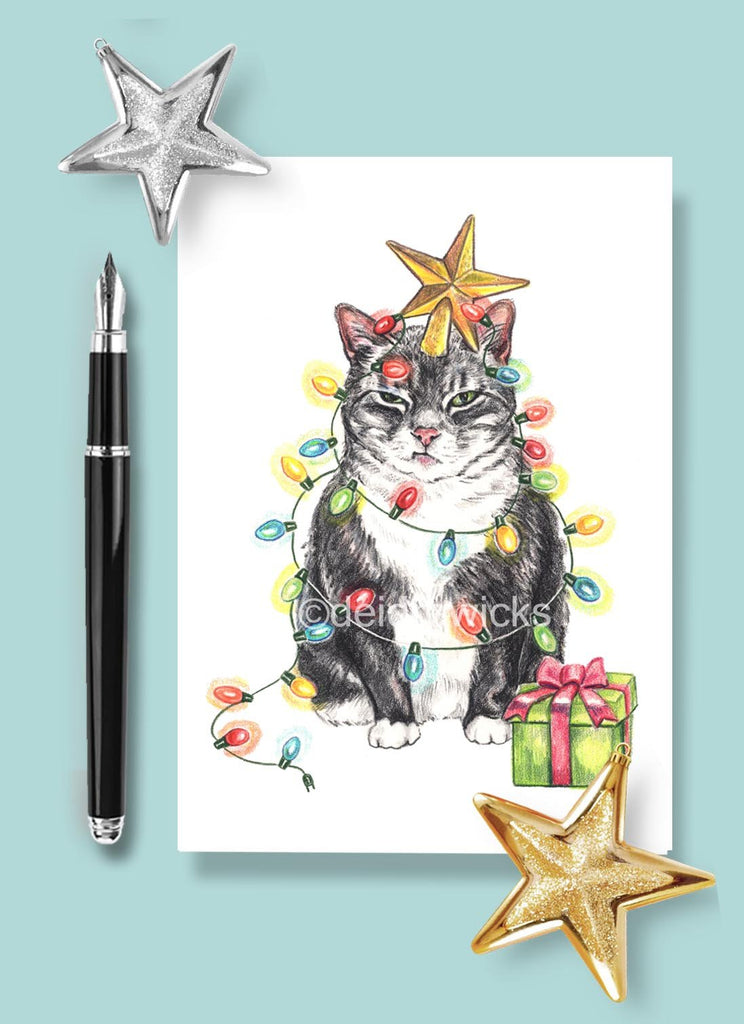 A crayon drawing of a grumpy cat wrapped in Christmas lights by Deidre Wicks