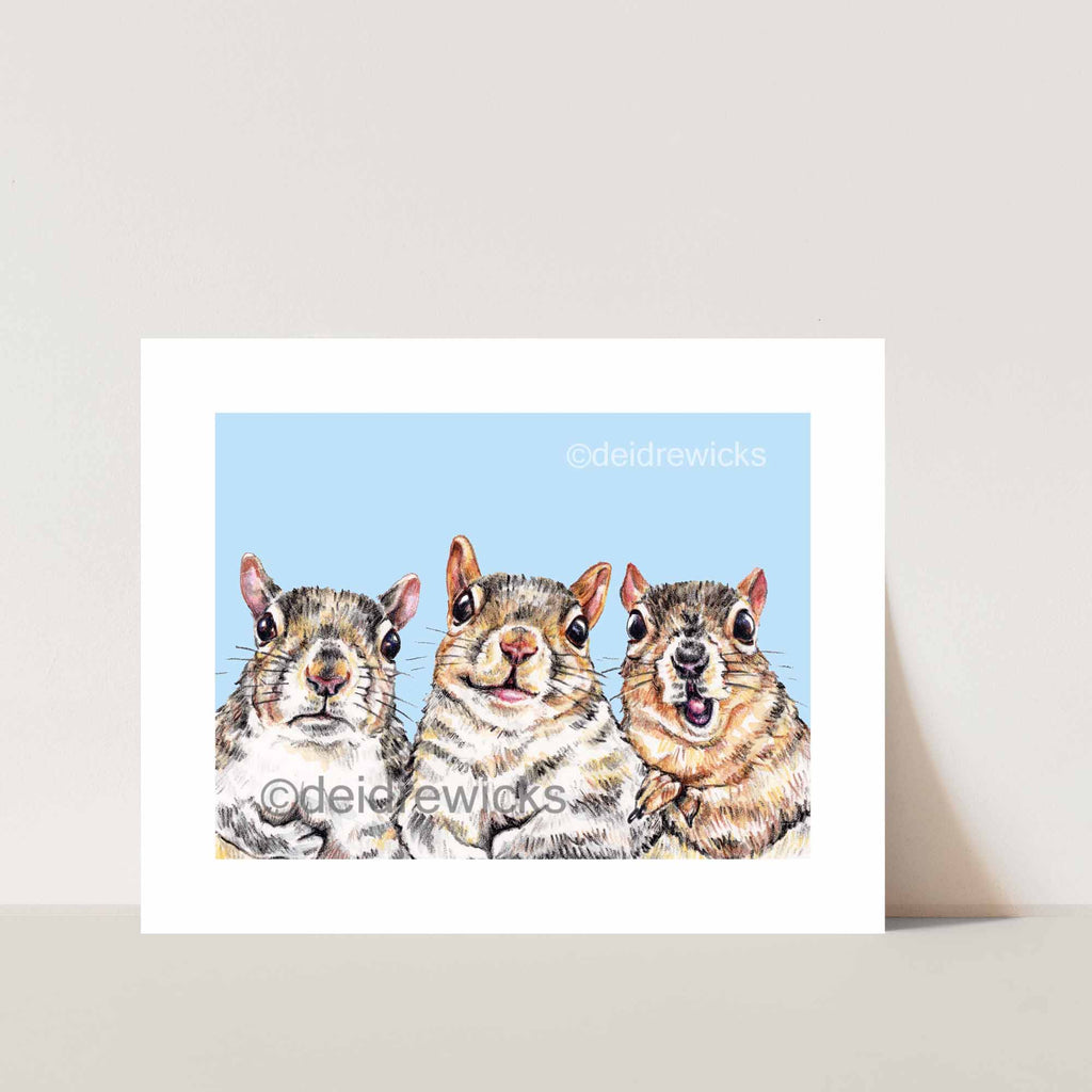 An 8x10 fine art crayon print featuring 3 different squirrels against a blue background by artist Deidre Wicks