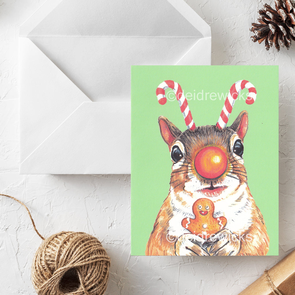 Christmas greeting card featuring a crayon drawing of a squirrel who really loves the season!