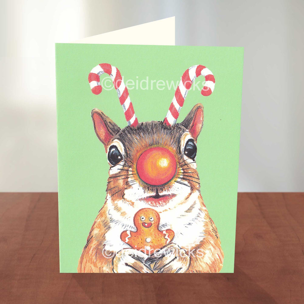 Blank A2 Christmas card featuring a squirrel with candy cane antlers and a Rudolph nose