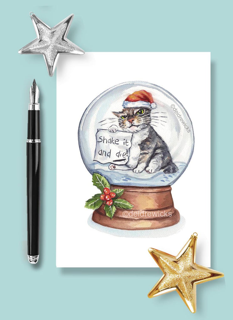 Watercolor Christmas card of an angry tabby cat inside a snow globe. Don't you dare shake it!