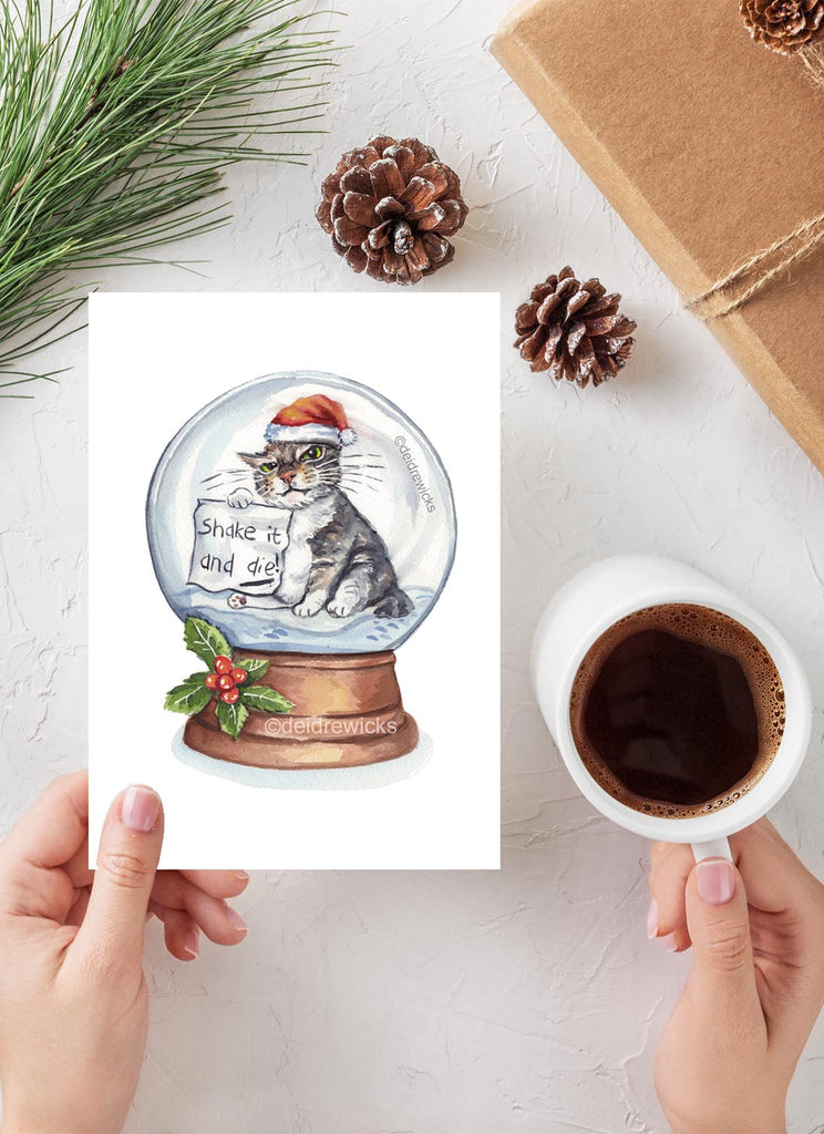 Watercolour Christmas card featuring a grumpy tabby cat inside a snow globe