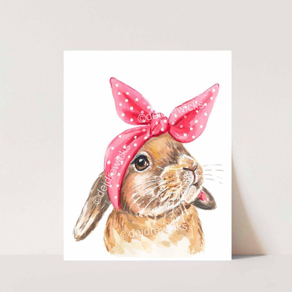 Watercolor print of a rabbit wearing a pink head scarf that looks like bunny ears