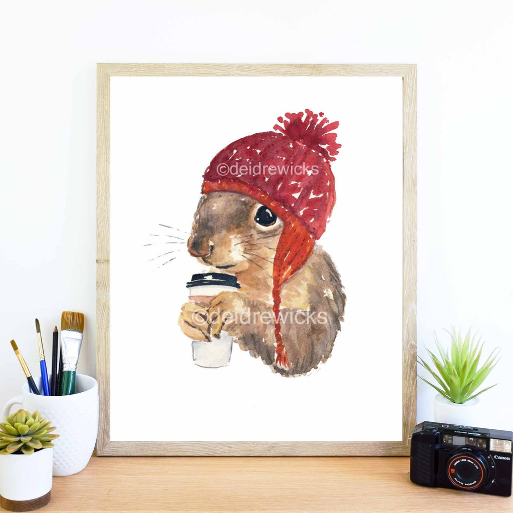 Framed example of a coffee drinking squirrel in a knit hat