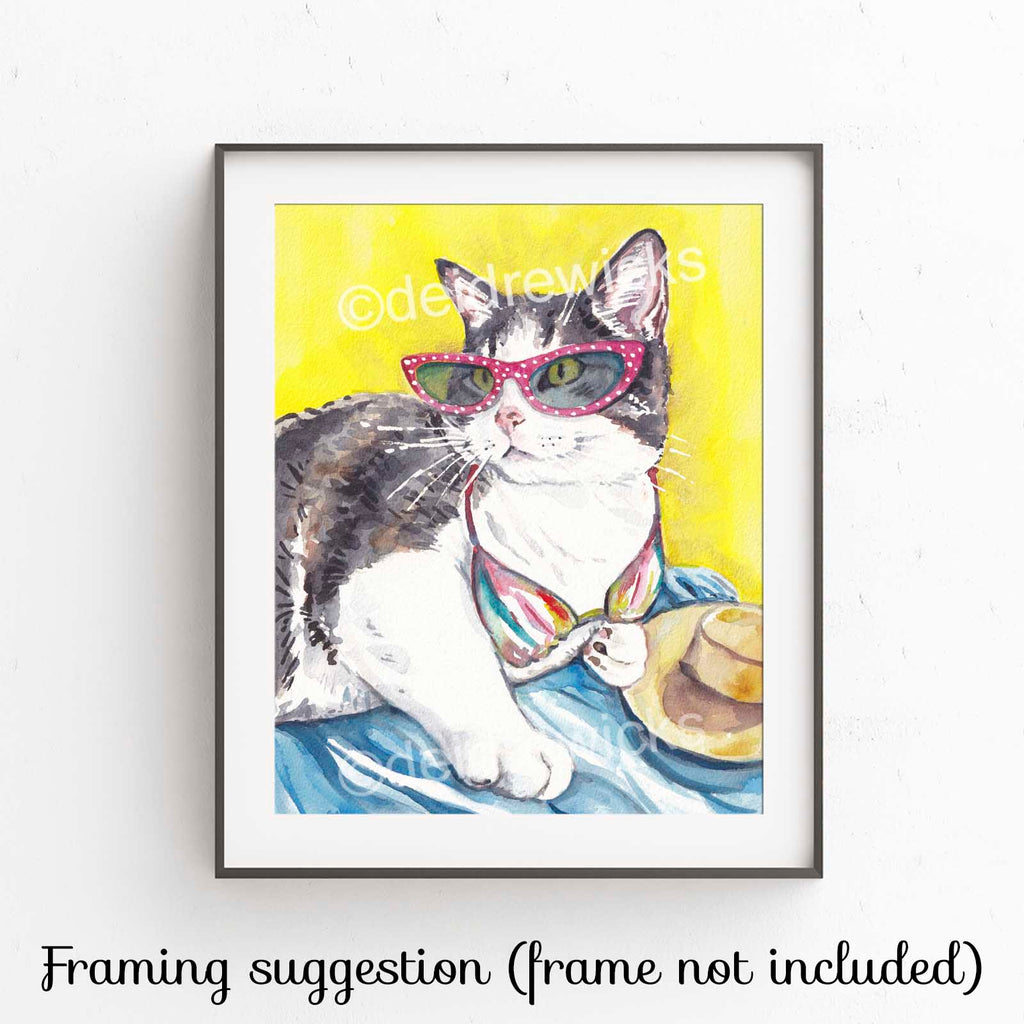 Cat watercolor painting of a tabby cat lying on a beach wearing sunglasses