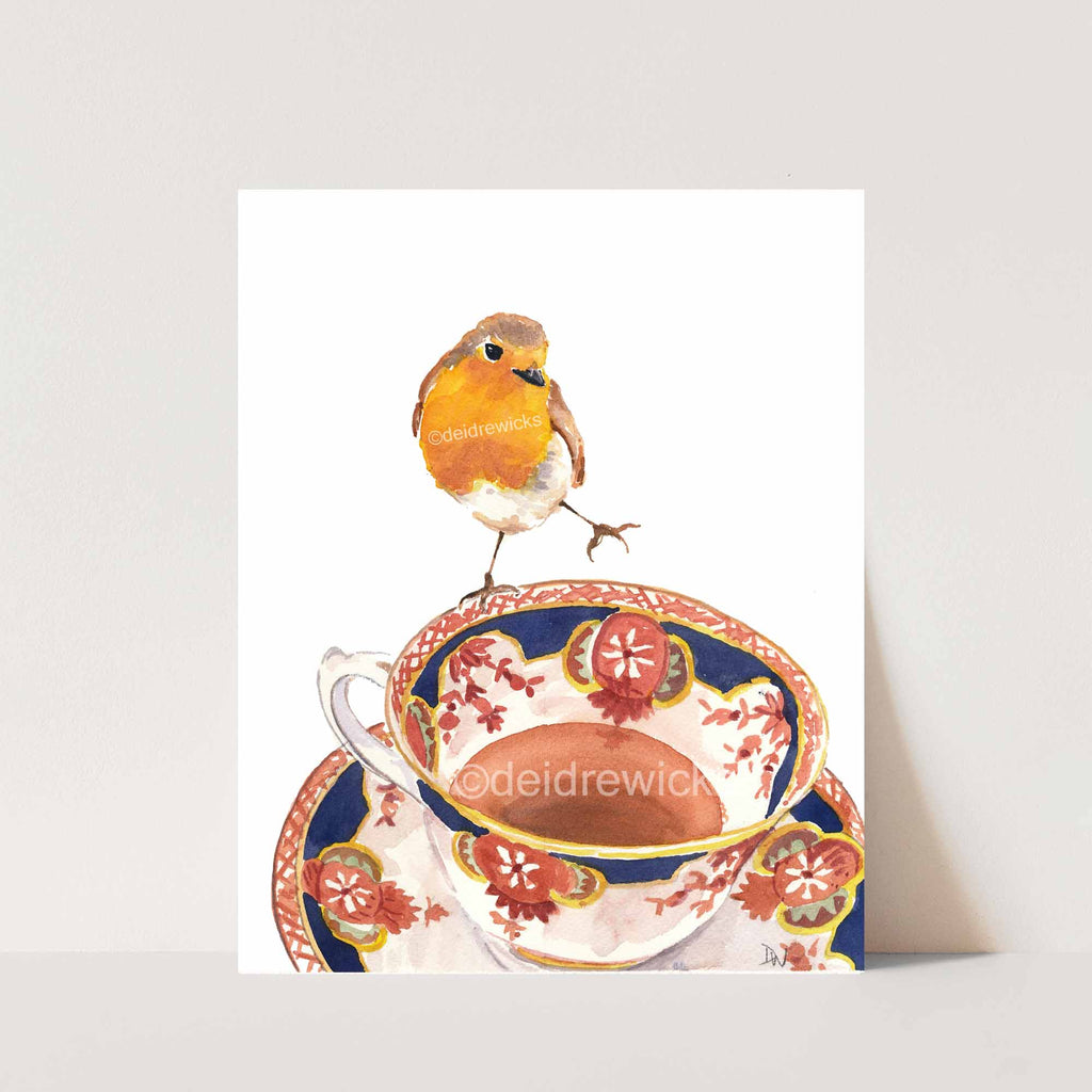 Watercolor painting of a robin bird balanced on the edge of a vintage tea cup