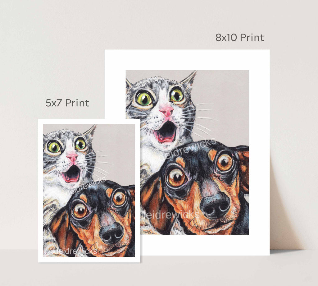 Size difference between prints of a tabby cat and dachshund dog by Deidre Wicks