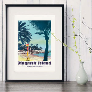 Alma Bay, Magnetic Island vintage art print in black frame with white vase