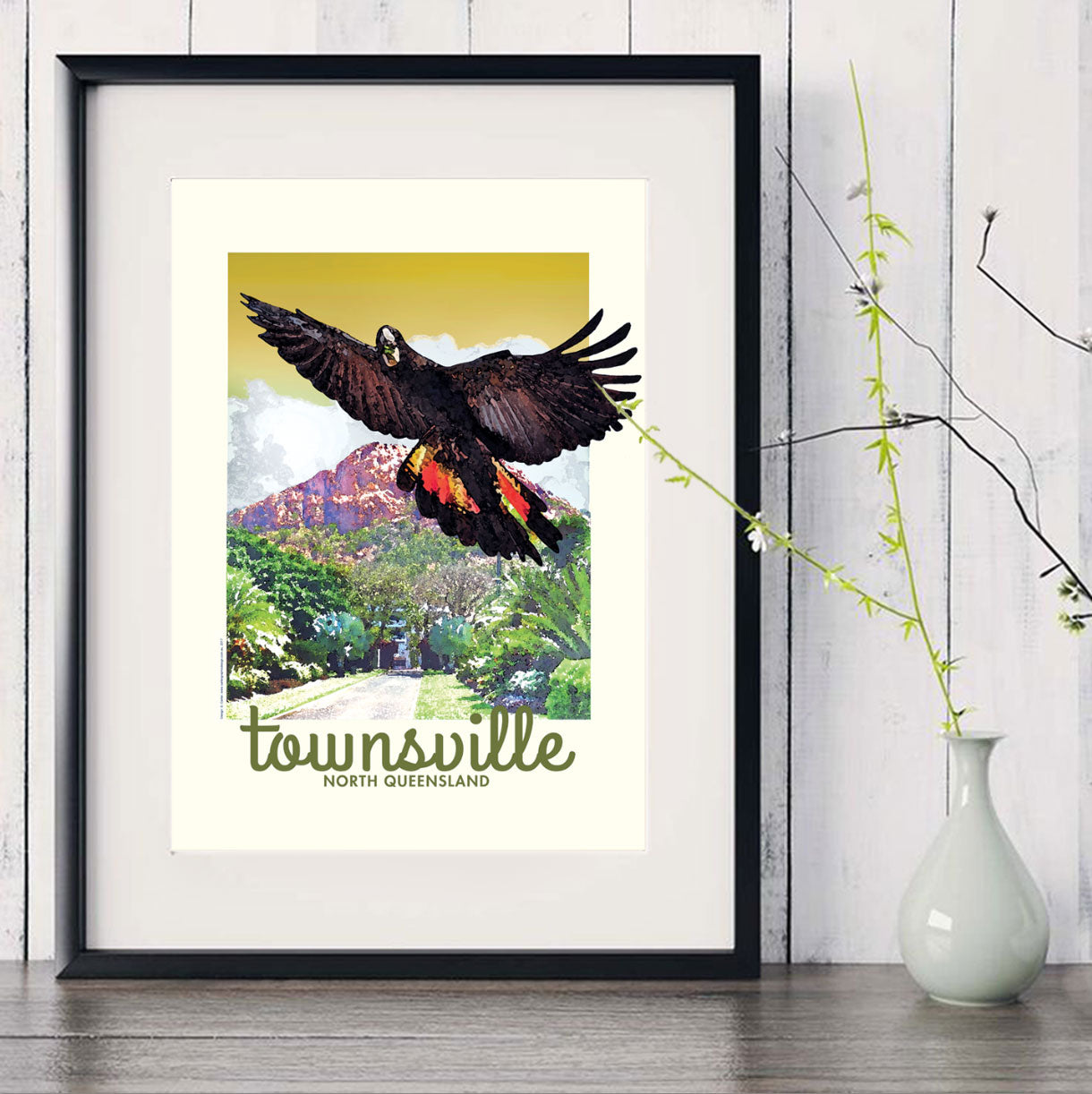 Townsville Black Cockatoo vintage art print in black frame with white vase