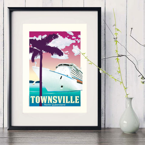 Townsville Cruise Ship art print in black frame with white vase