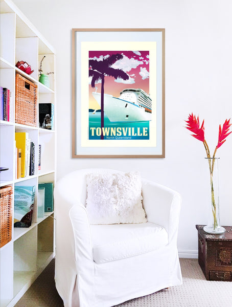 Townsville Cruise Ship poster print in wooden frame with armchair
