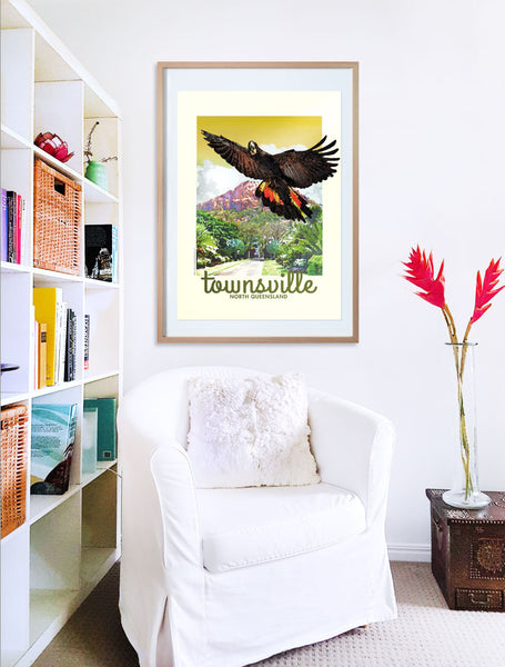 Townsville Black Cockatoo vintage poster print in wooden frame with armchair