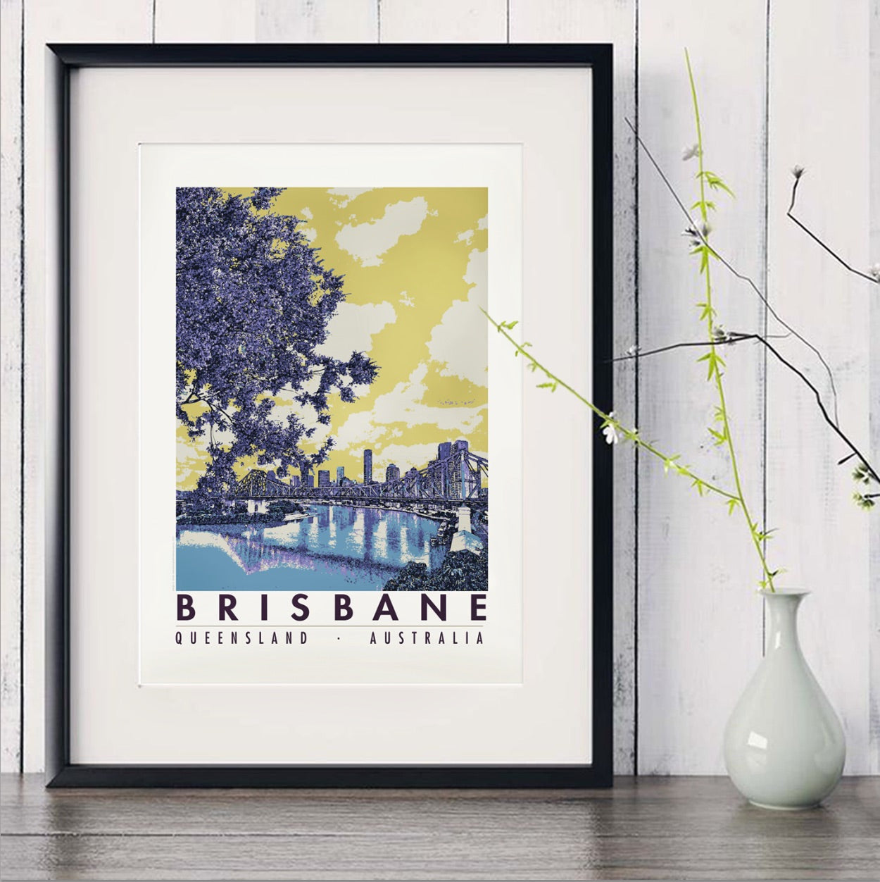 Brisbane River with Jacaranda art print in black frame with white vase