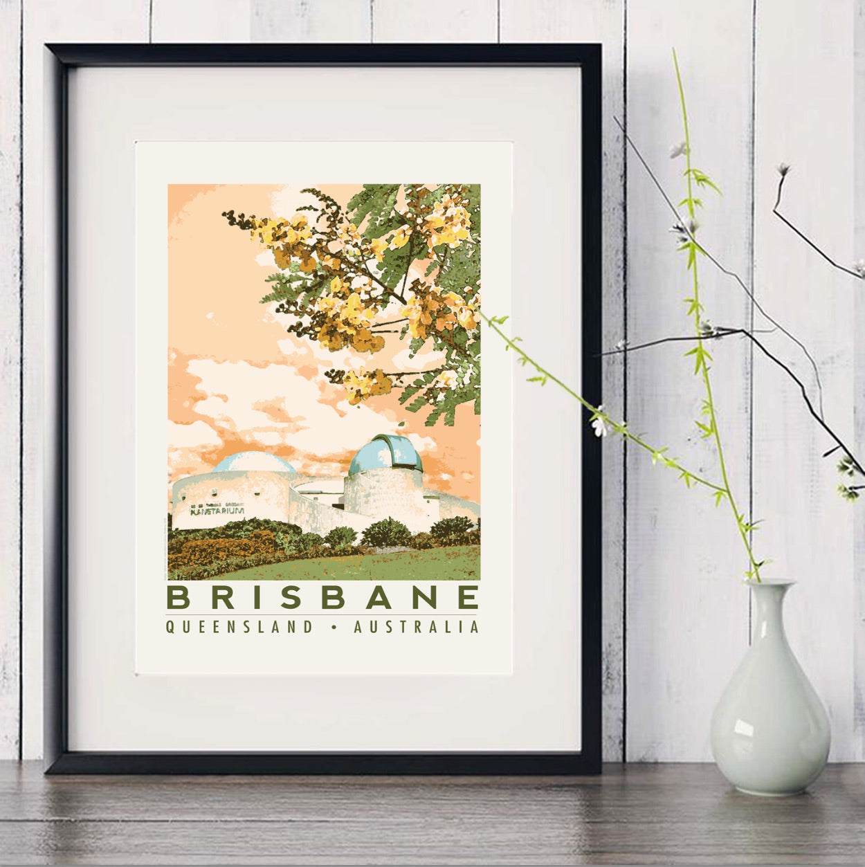 Brisbane Planetarium art print in black frame with white vase