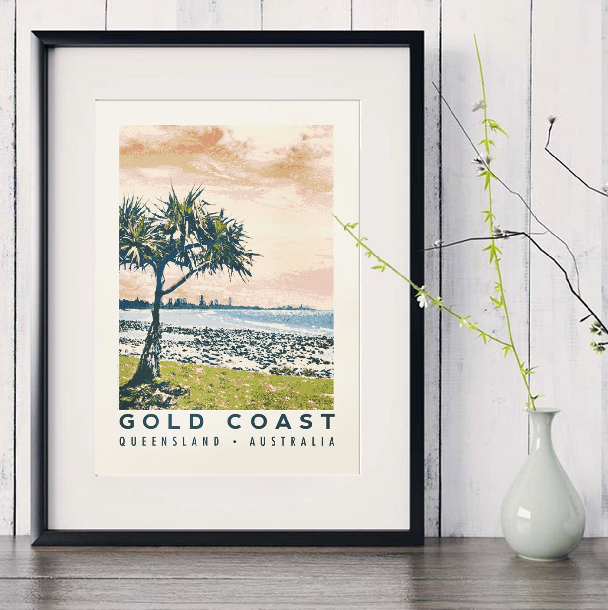 Burleigh Heads art print in black frame with white vase