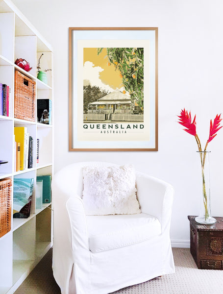 Queenslander house with mango tree poster print in wooden frame with armchair