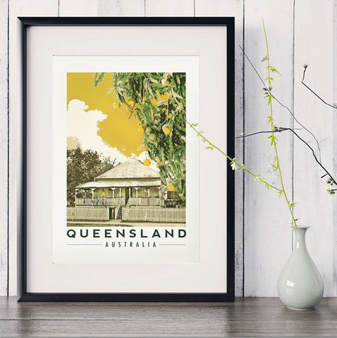 Queenslander house with mango tree art print in black frame with white vase