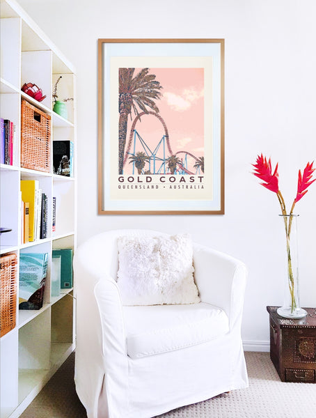 Gold Coast roller coaster with palms poster print in wooden frame with armchair