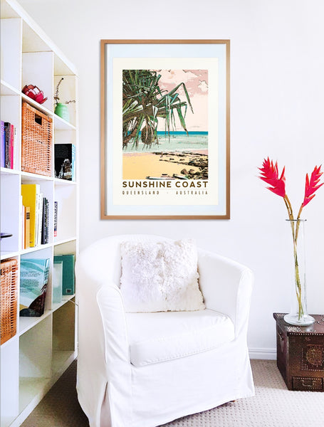 Sunshine Coast beach with pandanus poster print in wooden frame with armchair