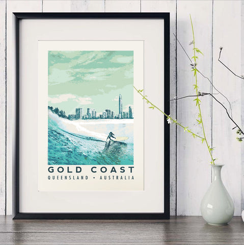 Blue surfer with Gold Coast skyline art print in black frame with white vase