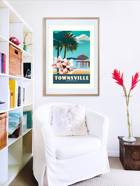Townsville The Strand with Frangipani poster print in wooden frame with armchair