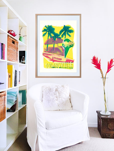 Townsville beach collage with surf board and ice-cream in front of the jetty poster print in wooden frame with armchair