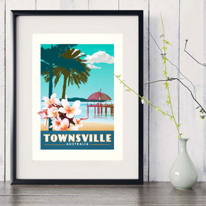Townsville The Strand with Frangipani art print in black frame with white vase