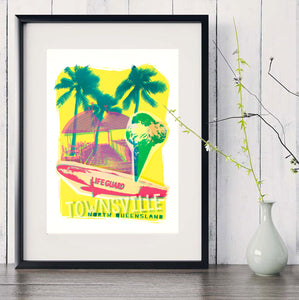 Townsville beach collage with surf board and ice-cream in front of the jetty art print in black frame with white vase