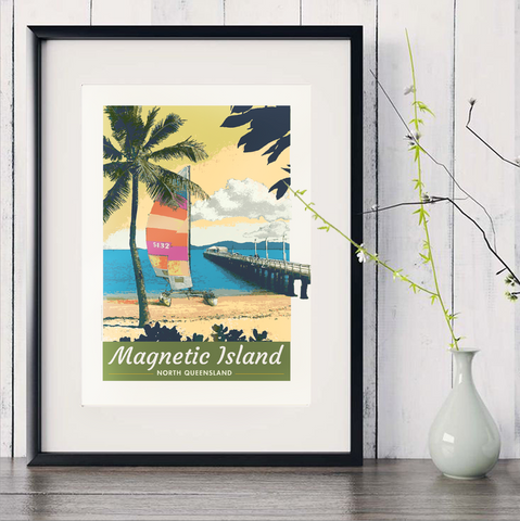 Picnic Bay, Magnetic Island art print in black frame with white vase