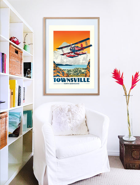 Townsville Red Baron flying over Castle Hill poster print in wooden frame with armchair