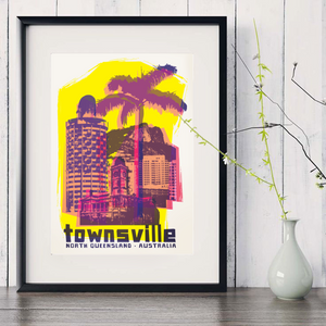 Townsville collage with Sugar Shaker and Castle Hill art print in black frame with white vase