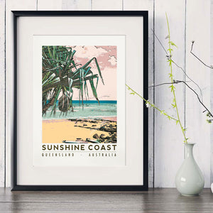 Sunshine Coast beach with pandanus art print in black frame with white vase