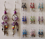 Earrings with feathers and multicolor beads