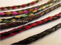 Bracelets in braided leather