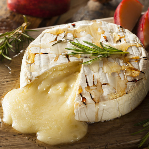 Impress your Guests with Grilled Brie Basted with Raw Honey, Roasted Garlic and Butter! Yum!