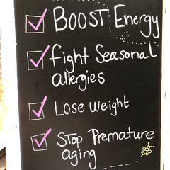At the art festival in Key West, Florida. Boost energy, fight seasonal allergies, loose weight, stop premature aging is written on our chock board..