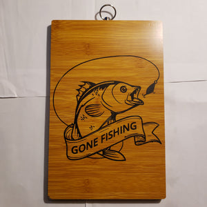 "Laser Etched ""Gone Fishing"" Bamboo Cutting Board Paddle Style"