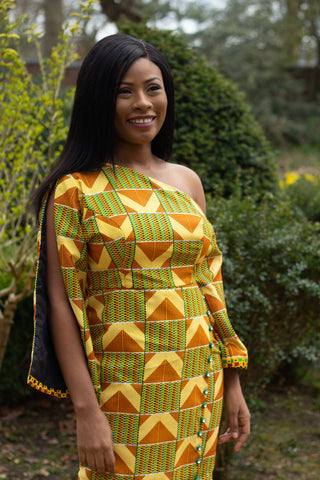 Black woman in colourful off shoulder African kente dress with button down detail