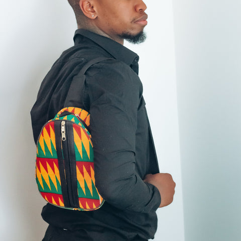 African Print Sling bag on a black man wearing a black shirt