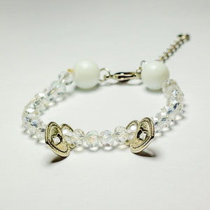 White beaded bracelet with heart locket pendants and chain clasp