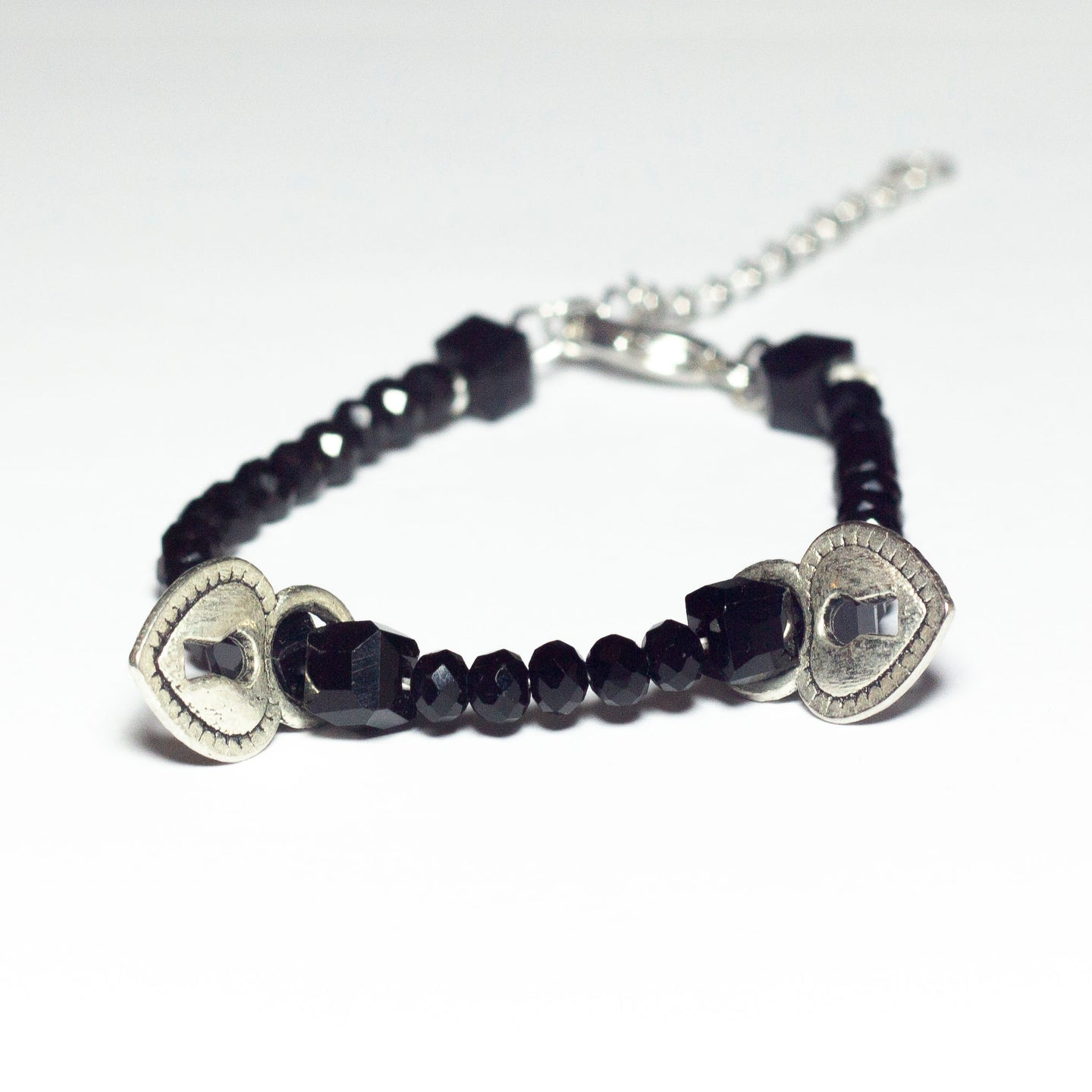 black beaded bracelet with heart locket pendants and chain clasp