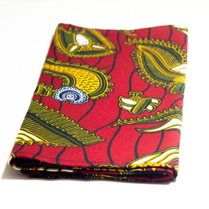 Red african print head wrap made from red, yellow, black and white ankara wax print