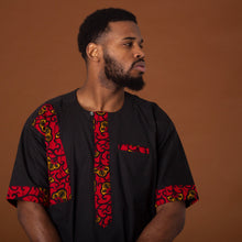 Load image into Gallery viewer, Black short-sleeved kaftan top with african print trim on the sleeves, pockets and neckline made from red, yellow and black ankara wax print fabric