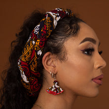 Load image into Gallery viewer, African print butterfly earrings with a striking red, yellow, white and black ankara wax print in a geometric pattern